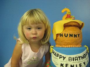 Two year old birthday girl and cake image