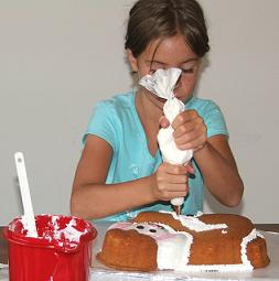 girl decorating cake image