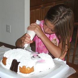girl decorating lamb cake image