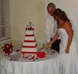 cutting wedding cake image