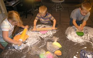 kids making birthday cakes image