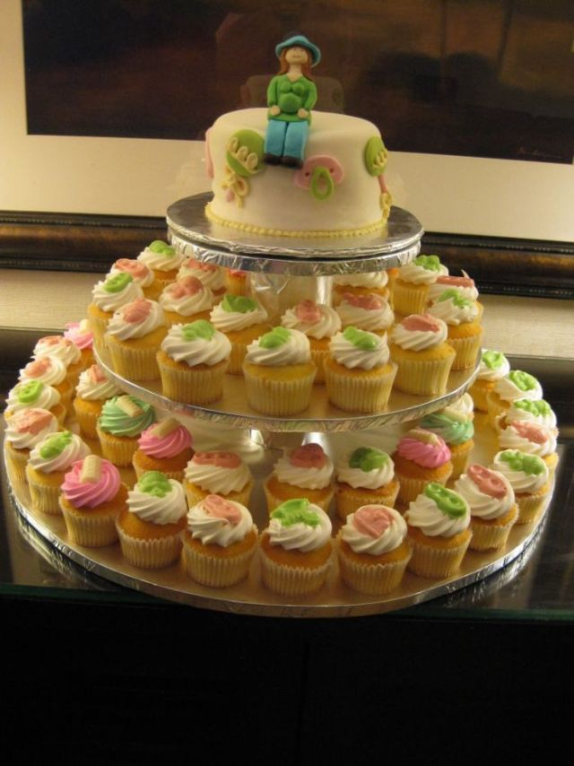 these baby shower cake cupcakes were topped with candy melts and